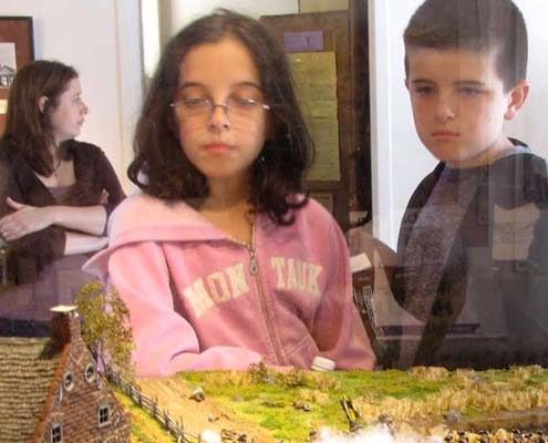 Students view the Battle of Brooklyn exhibit at OSH