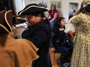 Kids dressing up in Revolutionary War costumes