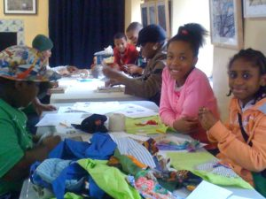 Children making fabric collages at an OSH after school program