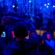 a group of people attend a silent disco wearing light up headphones