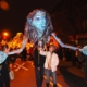 Parade goers manipulate a giant puppet